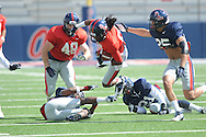 Ja-Mes Logan (85) is tackled at Ole Miss football scrimmage at Vaught-Hemingway Stadium in Oxford, Miss. on Saturday, April 6, 2013.