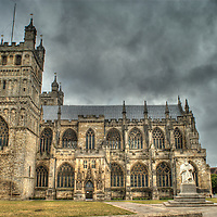 Exeter Cathedral between rain showers. Exeter cathedral, Exeter, Devon, England.  The cathedral building dates from the 11th century (construction started around 1265-70).  This is an HDR (High Dynamic Range) image created from a composite of four separate RAW images, each taken two stops apart.