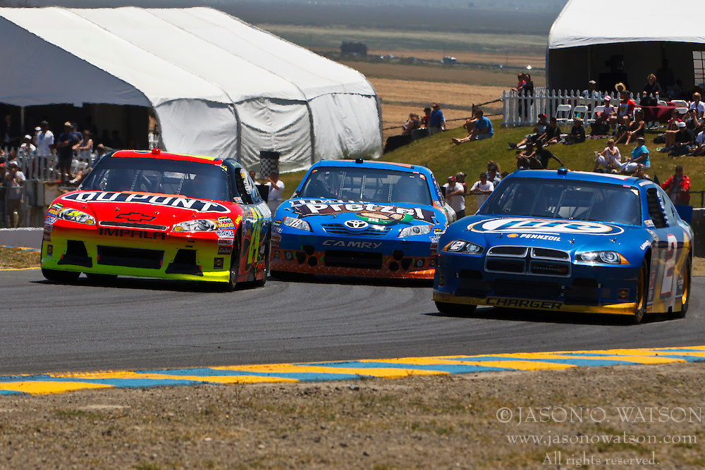 June 26, 2011; Sonoma, CA, USA;  NASCAR Sprint Cup Series driver Jeff Gordon (left), driver Kyle Busch (center) and driver Brad Keselowski (right) in turn 2 during the Toyota/Save Mart 350 at Infineon Raceway.