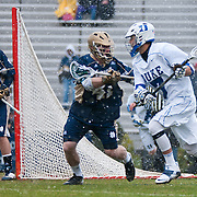 Duke midfielder Jake Tripucka #7  is guarded by Quinn Cully Midfield #41. The third-ranked Fighting Irish defeated sixth-ranked Duke, 13-5, in men's lacrosse action on a snowy Saturday afternoon at Koskinen Stadium in Durham, N.C.