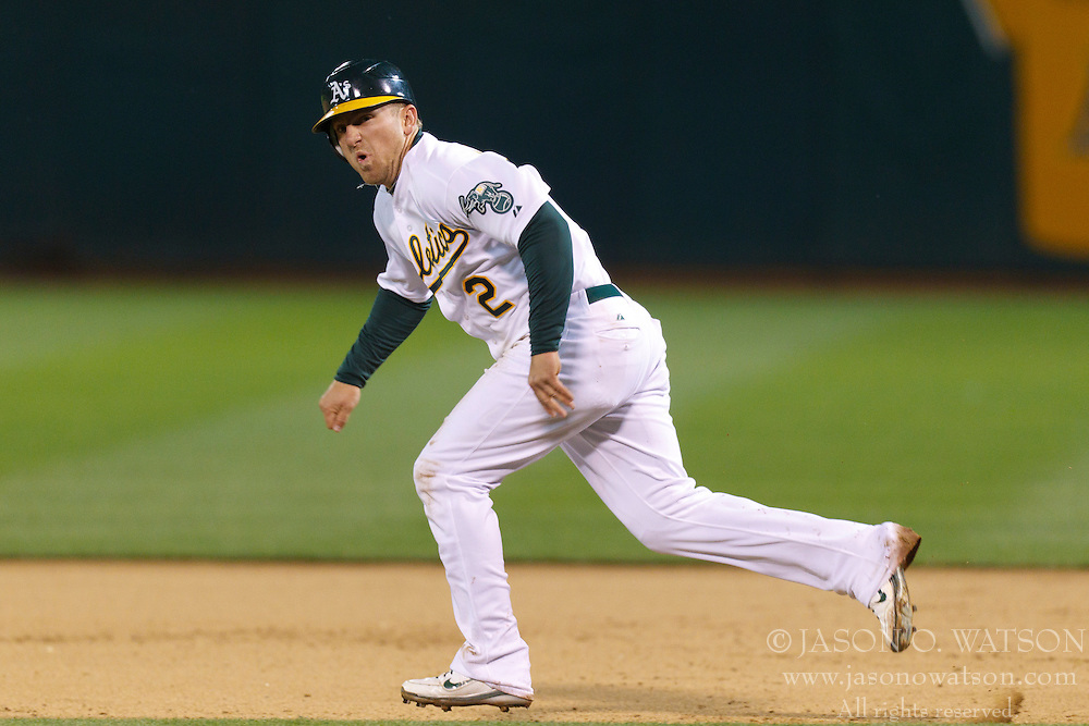 May 16, 2011; Oakland, CA, USA;  Oakland Athletics shortstop Cliff Pennington (2) runs to second base against the Los Angeles Angels during the fifth inning at Oakland-Alameda County Coliseum.  Oakland defeated Los Angeles 5-4 in ten innings.