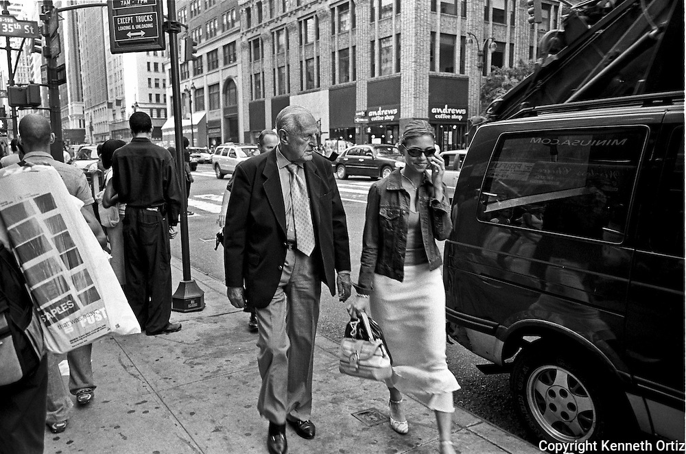 Walking up 7th Avenue in New York City I came upon this moment where the older man seemed to be annoyed by the young lady on the phone. She was totally oblivious her surroundings.