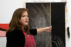 April VanDeGrift in her studio talks about this etched painting where she respond one line to the next rather than trying to control each line. April's shared studio with Susan Madacsi and Erin Cunningham was one of the venues on Jodi Eichelberger's ST(r)EAM Artist Studio/Gallery bike tour in the Surel Mitchell Live-Work-Create District in Garden City, Idaho on June 18, 2016.<br /> <br /> Tour started at the studios of Susan Madacsi, April VanDeGrift, Erin Cunningham, and continued to Ken McCall Studios, James &amp; Matt Wilson of Red Valley Mandolins, Arin Arthur, Angie Bowling Sebolt, Belinda Isley, Matt Herberg, Lisa Roggenbuck and the Visual Arts Collective.