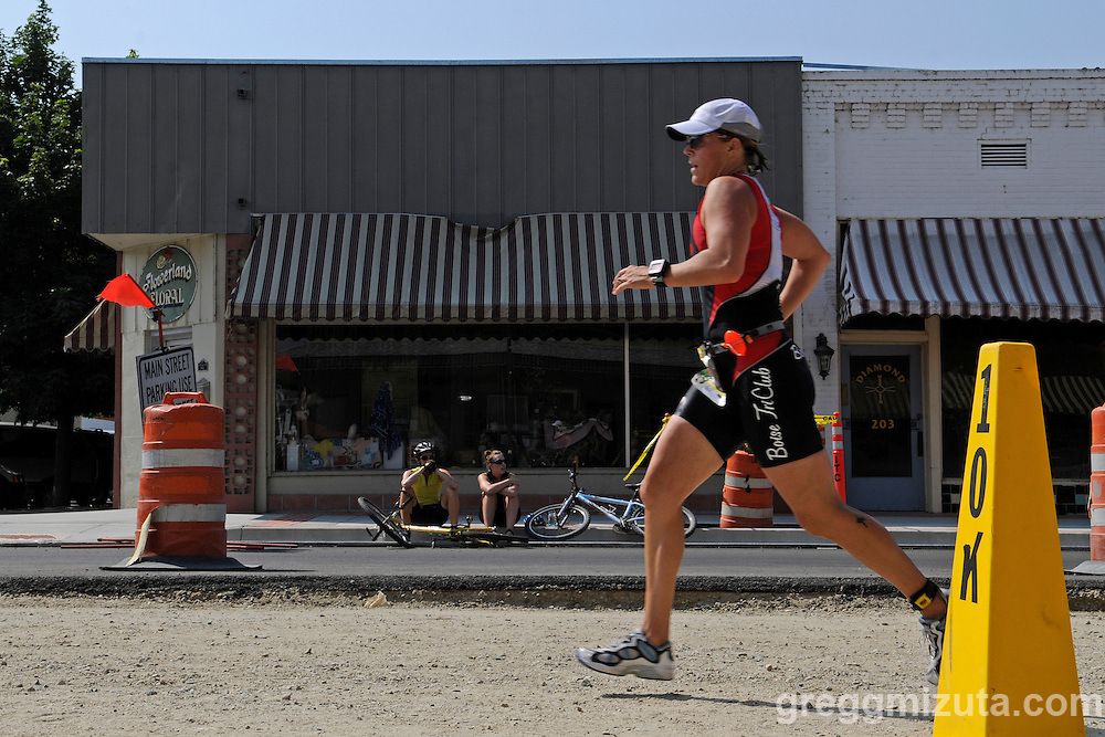 Mary Williams runs on Main Street in downtown Emmett during the Emmett's Most Excellent Triathlon on August 7, 2010.<br /> <br /> Williams finished the Olympic distance triathlon (1.5k swim, 40k bike and 10k run) in 2:33:00 to finish eleventh overall female and first in the female 35-39 age group.