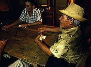 Playing dominoes near La Maquina, Guantanamo, Guantanamo, Cuba.
