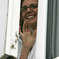 Hilary Stollo, a 19-year-old Virginia Tech freshman shooting victim waves at the visiting Virginia Tech marching band playing in the parking lot outside her hospital room in Blacksburg, Virginia April 19, 2007.  Strollo was shot three times while in her French class. REUTERS/Rick Wilking (UNITED STATES)