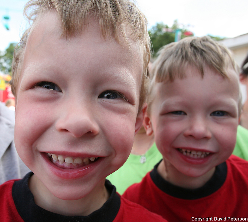 """Four year old twins wait for competition to begin in the """"Twins, Triplets and More"""" competition at the Iowa State Fair in 2007."""