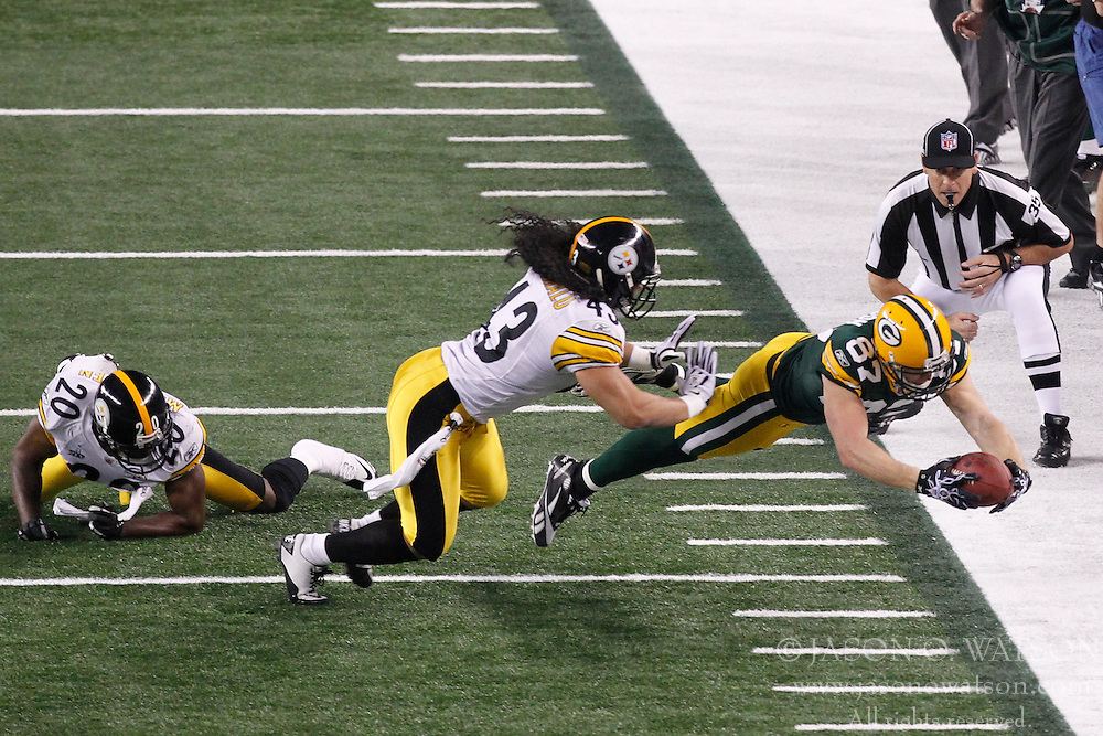 Feb 6, 2011; Arlington, TX, USA; Green Bay Packers wide receiver Jordy Nelson (87) dives for extra yardage past Pittsburgh Steelers safety Troy Polamalu (43) and cornerback Bryant McFadden (20) during the first half of Super Bowl XLV at Cowboys Stadium.  Green Bay defeated Pittsburgh 31-25.