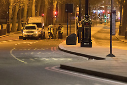 Victoria Embankment, London, January 19th 2017. Bomb disposal experts from the Royal Navy at Victoria Embankment to defuse and remove an unexploded bomb discovered,  between Hungerford Bridge and Westminster Bridge, near the Houses of Parliament, by engineers working in the River Thames. PICTURED: Navy bomb disposal team, fire service and police in discussion on Embankment.