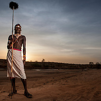 Samburu warrior with spear in a riverbed in northern Kenya