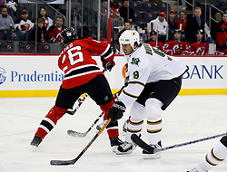 November 28, 2007; Newark, NJ, USA;  Dallas Stars center Mike Modano (9) and New Jersey Devils left wing Patrik Elias (26) battle in front of the goal during the first period at the Prudential Center in Newark, NJ.
