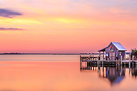 The Manteo boathouse with a Christmas wreath at sunrise.