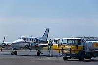 A Beech King Air being serviced by a fuel truck