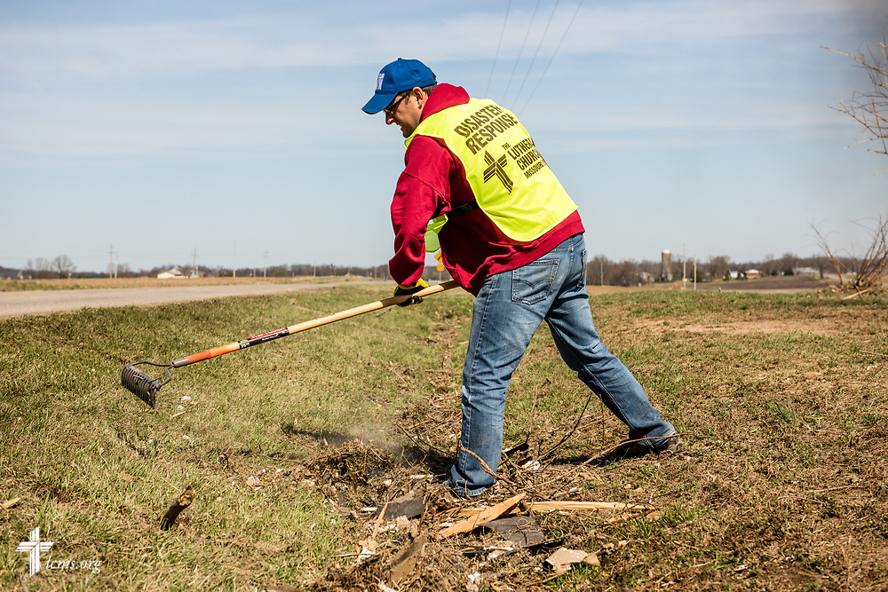 Travis Torblaa, mission and ministry director at New Beginnings Lutheran Church, Pacific, Mo., rakes debris at a destroyed home on Saturday, March 4, 2017, in Perryville, Mo. LCMS Communications/Erik M. Lunsford