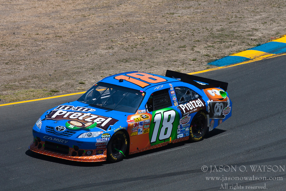 June 26, 2011; Sonoma, CA, USA;  NASCAR Sprint Cup Series driver Kyle Busch (18) in turn 2 during the Toyota/Save Mart 350 at Infineon Raceway.
