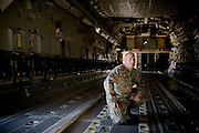 Technical Sgt. Kurt Hollensteiner kneels inside a C-17 Globemaster aircraft under maintenance by the 315th Aircraft Maintenance at Charleston Charleston Air Force Base, S.C., on Oct. 30, 2008.