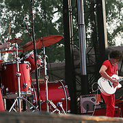 The White Stripes with Meg White (drums and vocals) and Jack White (vocals and guitar) performs during the fourth day of the 2007 Bonnaroo Music & Arts Festival on June 17, 2006 in Manchester, Tennessee. The four-day music festival features a variety of musical acts, arts and comedians..Photo by Bryan Rinnert