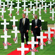 .THE IMMACULATELY-KEPT AMERICAN MILITARY CEMETERY AT MADINGLEY NEAR CAMBRIDGE WHERE 4,000 US SERVICEMEN ARE BURIED. THE AMERICANS ARE INCREASING SPENDING ON WAR GRAVES PIC SHOWS PRESIDENT CLINTON AND JOHN MAJOR ON A VISIT TO THE CEMETERY IN 1994....