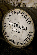 Laphroaig malt whisky distillery, Islay, Scotland. An empty cask of Laphroaig whisky, signed by Prince Charles. Laphroaig whisky is the favourite malt whisky of Prince Charles.