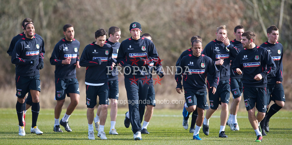CARDIFF, WALES - Tuesday, March 2, 2010: Wales' captain James Collins leads his side during training at the Vale of Glamorgan Hotel ahead of the international friendly match against Sweden. (Photo by David Rawcliffe/Propaganda)