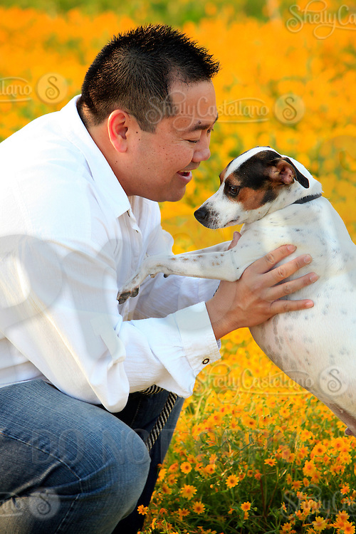 25 March 2010:  Musician and teacher Paul Navidad casual photo session at the beach and park in Huntington Beach, CA with his dog Eddie.