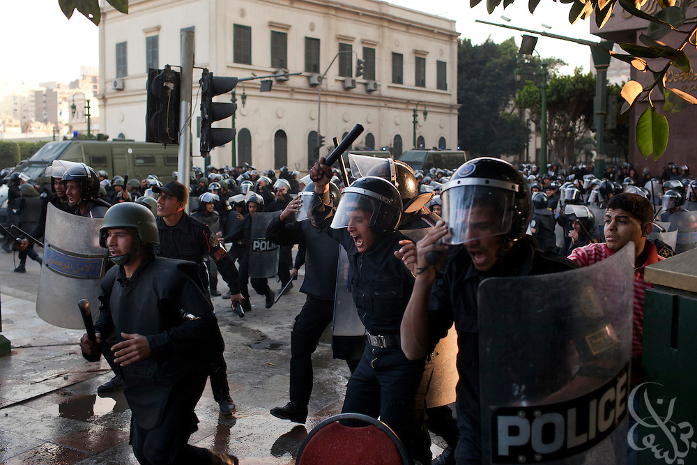 "Egyptian riot police charge during a battle with thousands of protesters during January 25, 2011 ""Day of Anger"" demonstrations in downtown Cairo, Egypt. Today's protests across Egypt, inspired by the revolution in Tunisia, were organized by a wide range of opposition groups and intended to spark a similar movement in Egypt. Credit: Scott Nelson"