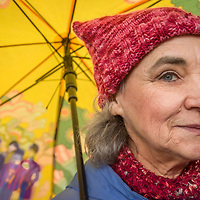 Joan Temple joins with the women of Calistoga as they march on a rainy day to demonstrate their opposition to President Trump and his anti-women policies.
