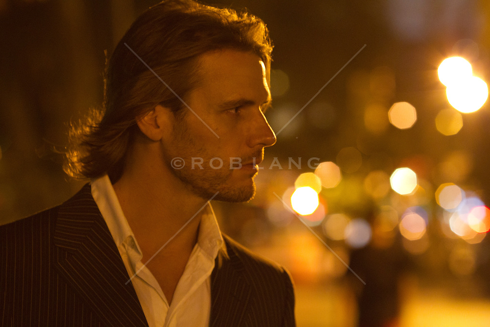 man in a blazer and shirt on the street of new york city at night rob lang images licensing. Black Bedroom Furniture Sets. Home Design Ideas