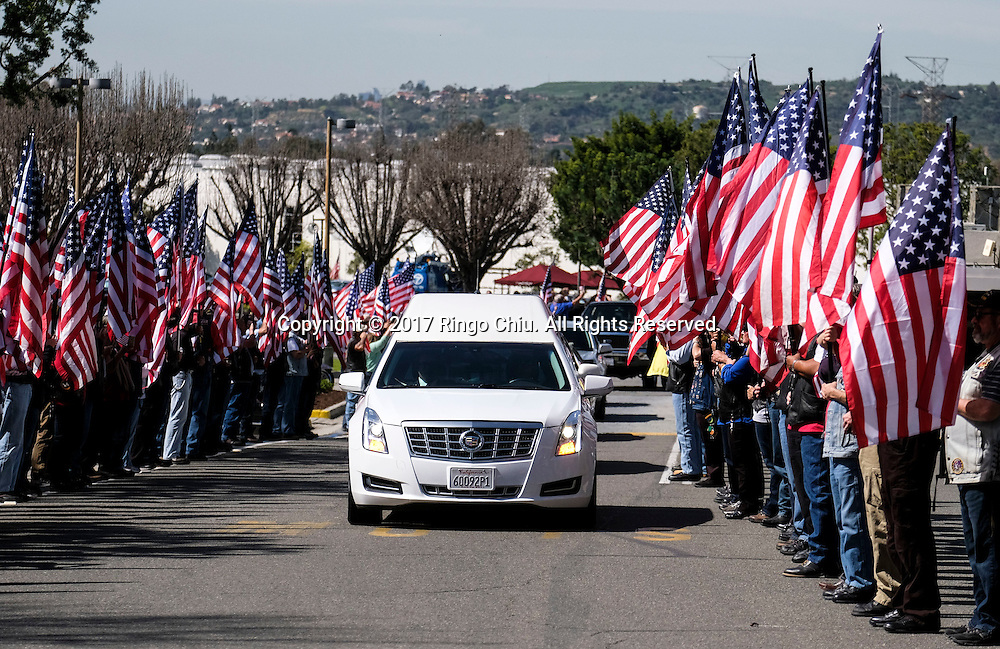 The hearse carrying the body of Whittier Police Officer Keith Boyer arrives at Rose Hills Memorial Park in Whittier, Calif., Friday March 3, 2017. Boyer, who was fatally shot after responding to a traffic crash, was remembered today by thousands of law enforcement officers, friends and family as a dedicated public servant, talented drummer, loving friend and even a ``goofy'' dad.(Photo by Ringo Chiu/PHOTOFORMULA.com)<br />