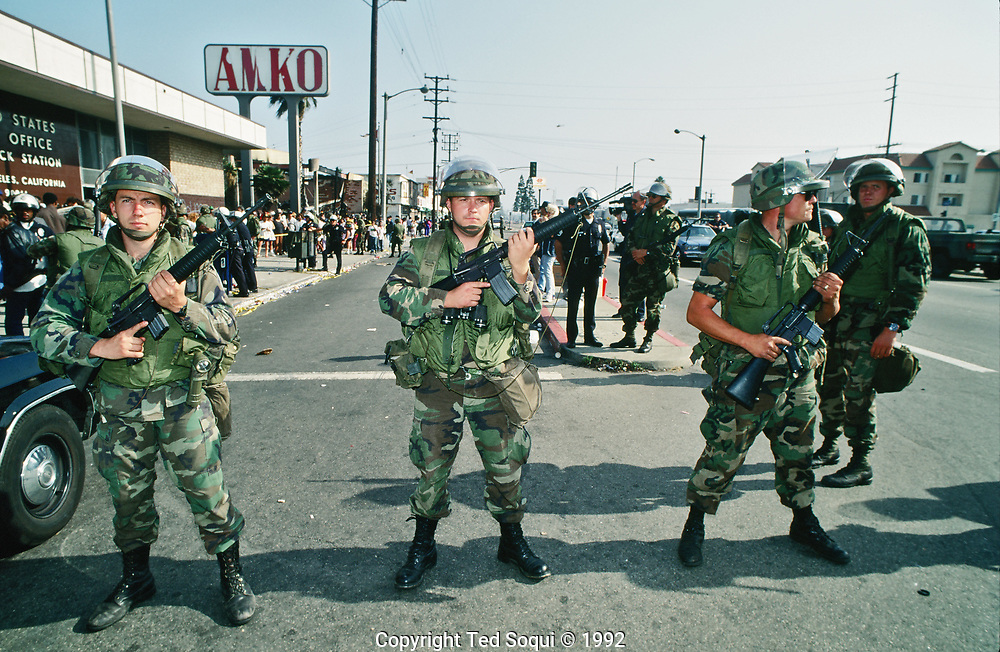 Armed National Guard soldiers hold a line in front of a post office on S.Vermont Ave in South Central L.A.