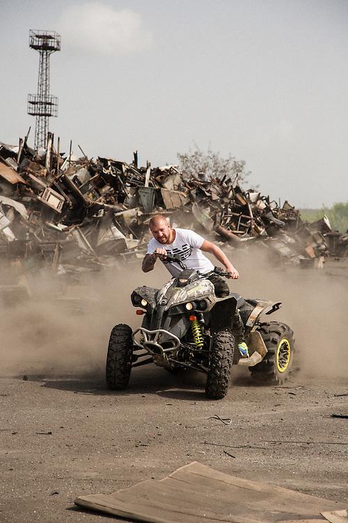 Dinko Valev rides his ATV 4x4 around his junkyard in Yambol, Bulgaria. <br /> <br /> Matt Lutton / Boreal Collective for VICE