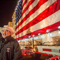 Regusci Vineyard's Carlos Avalos prepares for the start of the Calistoga Lighted Tractor Parade