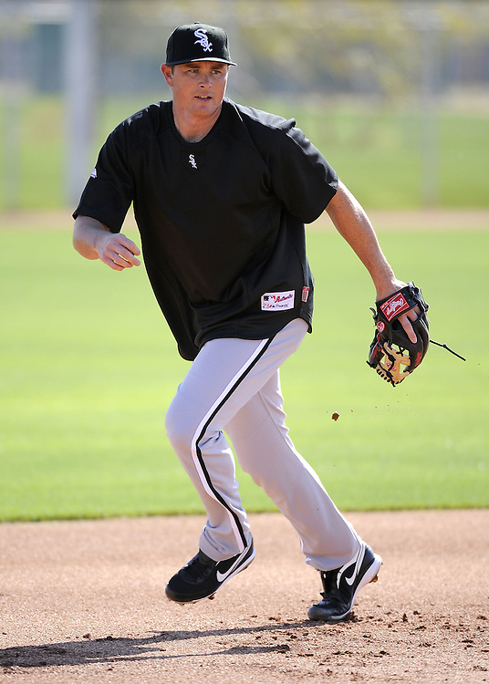 GLENDALE, AZ - FEBRUARY 23:  Mark Teahen #23 of the Chicago White Sox fields during a spring training workout on February 23, 2010 at the White Sox training facility at Camelback Ranch in Glendale, Arizona. (Photo by Ron Vesely)