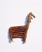 0107-1113B ~ Copyright: George H.H. Huey ~  Palm sized, split twig figurine, representing a deer or bighorn sheep.  Made single split willow twig.  Archaic culture. @2,000 B.C. found in a cave at Grand Canyon.  Grand Canyon National Park, Arizona.