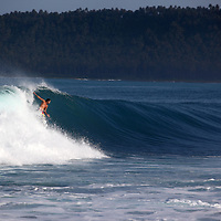 Surfing a left in Sumatra.