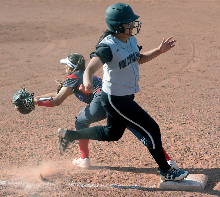 gbs032117i/SPORTS -- Volcano Vista's Audry Jim beats the throw to Sandia first baseman Maddie Romkowsky  in the 3rd inning during the game at Volcano Vista on Tuesday, March 21, 2017. (Greg Sorber/Albuquerque Journal)