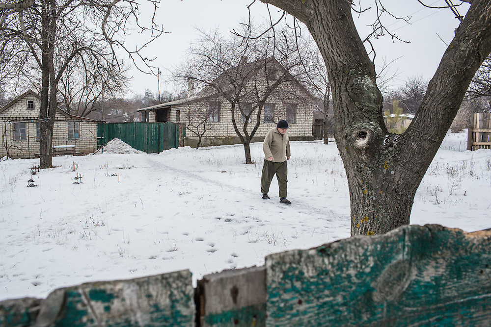 SNEZHNE, UKRAINE - JANUARY 25, 2015: Vladimir Moroz, who used to operate his own small coal mine across the street from his house, in his yard in Snezhne, Ukraine. The area is well known for its many coal mines, both large operations and small backyard operations. CREDIT: Brendan Hoffman for The New York Times