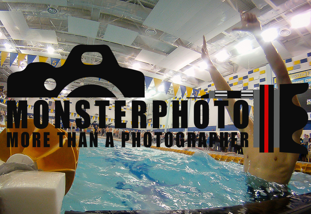 02/25/12 Newark DE: Salesianum Senior Matthew Tankle gesture the number 7 with his hands after winning the boys 100 yard back stroke  at the Boys swimming and diving state tournament Saturday, Feb. 25, 2012, at the Rawstrom Natatorium, UD sports complex in Newark, Del.<br /> <br /> Special to The News Journal/SAQUAN STIMPSON
