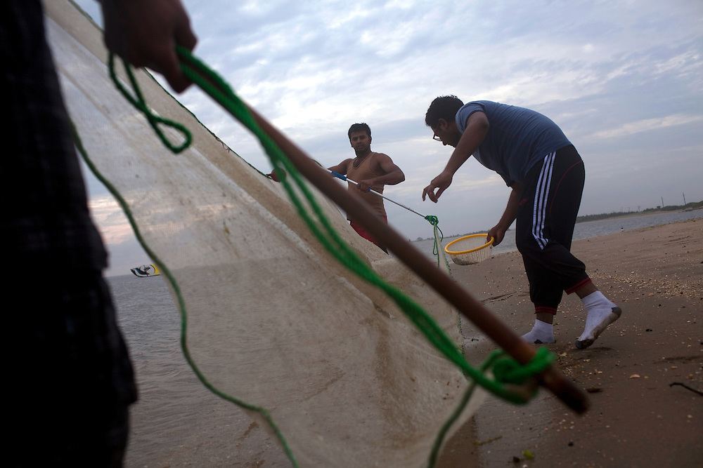 Sandy Hook, NJ - June 30, 2013 :  Ahsan Habib, left, Imran Habib, Center and Akram Habib, right, fish along the shores of Sandy Hook, NJ on June 30, 2013. People are returning to the New Jersey beaches for the summer after recovery efforts post Sandy.