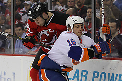 Apr 3; Newark, NJ, USA; New Jersey Devils right wing Cam Janssen (25) hits New York Islanders center Micheal Haley (18) during the second period at the Prudential Center.