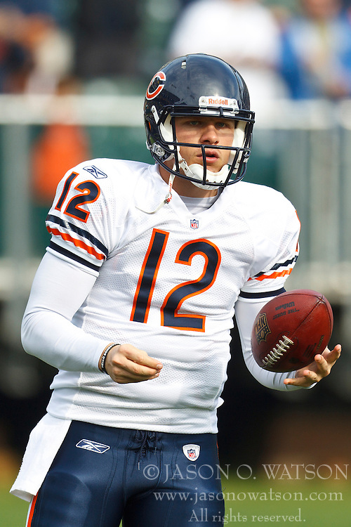 Nov 27, 2011; Oakland, CA, USA; Chicago Bears quarterback Caleb Hanie (12) warms up before the game against the Oakland Raiders at O.co Coliseum. Oakland defeated Chicago 25-20. Mandatory Credit: Jason O. Watson-US PRESSWIRE