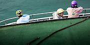 Ferry passengers with bike helmets. Kaohsiung, Taiwan.