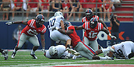 BYU's JJ Di Luigi (10) is tackled by Ole Miss' Damien Jackson (1) at Vaught-Hemingway Stadium in Oxford, Miss. on Saturday, September 3, 2011. BYU won 14-13.