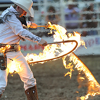 Rider Kiesner performs for the crowd during the Crooked River Roundup in Prineville on Friday.