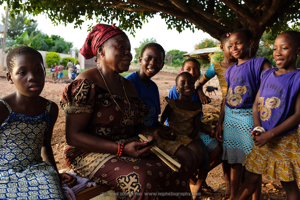 Mama Agblatsu III, a Queen Mother in Bankoe, a traditional division in the town of Ho in the Volta Region of Ghana, runs a weekly group meeting for children in her area, during which they learn traditional songs and games that are in danger of being lost.
