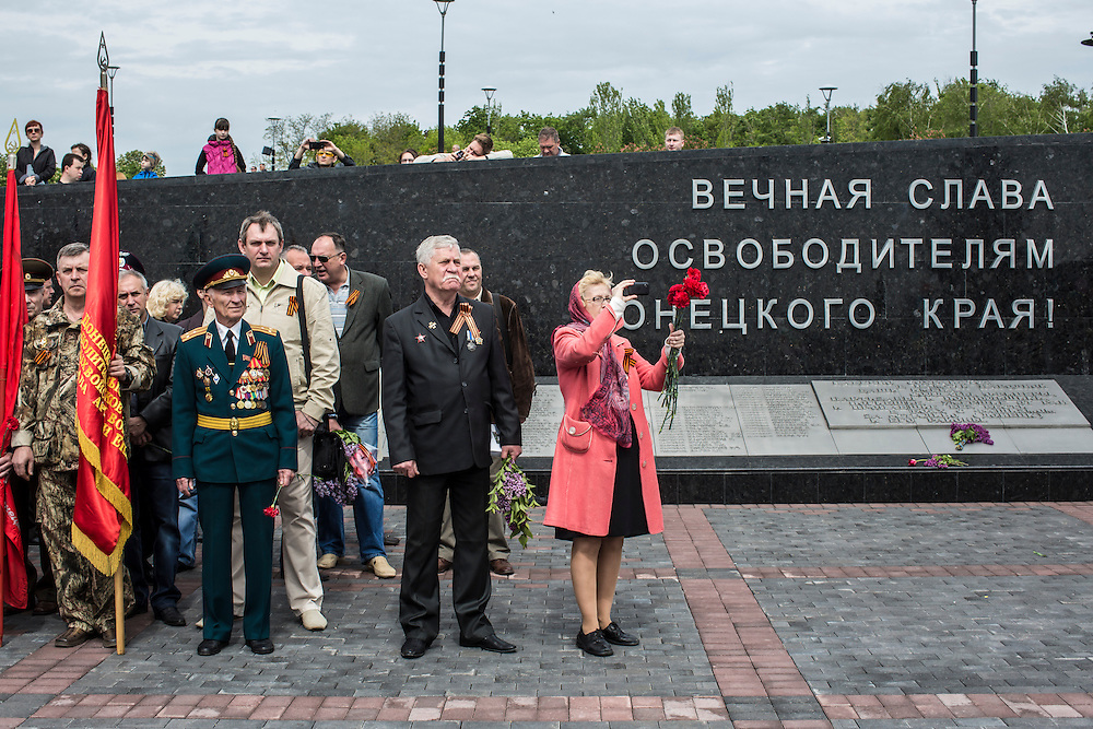 DONETSK, UKRAINE - MAY 9: People attend a ceremony commemorating victims of World War II on the Victory Day holiday on May 9, 2014 in Donetsk, Ukraine. Tensions in Eastern Ukraine are high after pro-Russian activists seized control of at least ten cities and ahead of the Victory Day holiday and a planned referendum on greater autonomy for the region. (Photo by Brendan Hoffman/Getty Images) *** Local Caption ***
