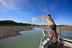Naturalist and tour guide Richard Costin casts for bait near Naturalist Island on the Kimberley coast.