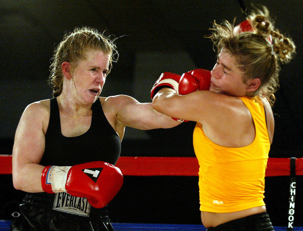 (LtoR) Tonya Harding of Vancouver goes toe-to-toe with Emily Gosa of Sulligent, AL.. Harding won after a four round decision though had to work hard for the victory.  They were 1 of 6 fights at Commotion at the Ocean 4 in Lincoln City.