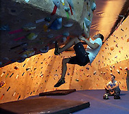 "Jamie Cordis from Davis. CA  works on a ""bouldering"" maneuver at the Sacramento Pipeworks climbing gym in Sacramento, Wednesday, January 5, 2005.  Watching is another climber Tony Cummings."