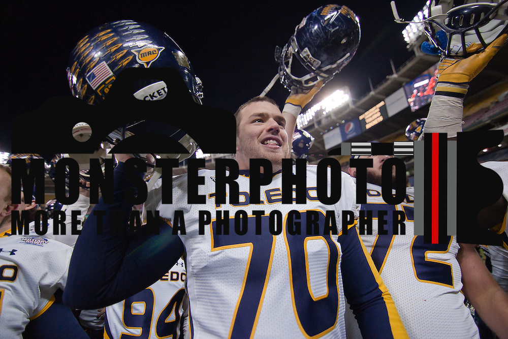 Toledo Rockets Defensive Linemen Ben Steele #70, Toledo Rockets Senior Offensive Linemen John Morookian #72 and the rest of there Toledo teammates celebrate their victory over Air Force in the 2011 Military Bowl Wednesday, Dec. 28, 2011 at RFK Stadium in Washington DC.